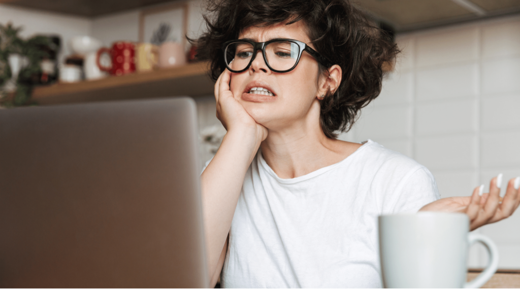 frustrated woman looking at laptop