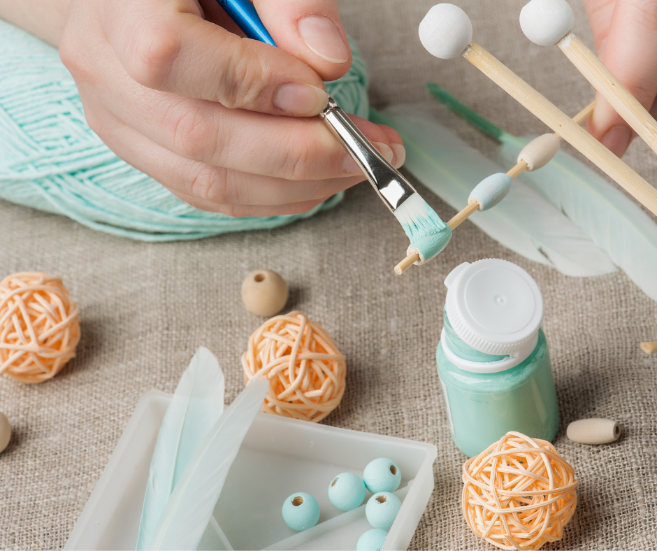 person painting a craft project