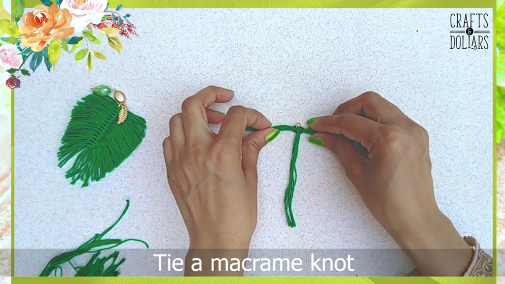 pushing the macramé knot to the top