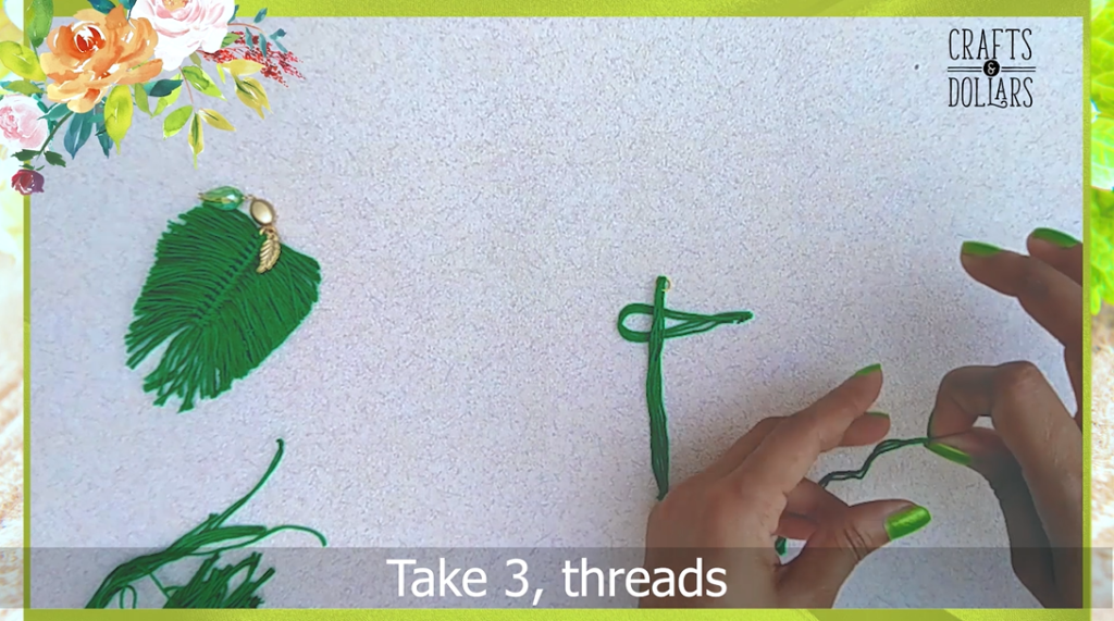 placing the looped threads